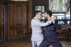 Танцоры выполняя танго Аргентины Стоковые Фотографии RF