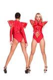 Танцоры в красном costume этапа Стоковая Фотография RF