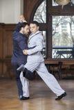 Танцоры танго выполняя шаг Gancho Стоковое Фото