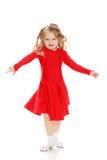 Танцы девушки в ярком красном платье стоковые изображения