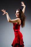 Танцы женщины танцуют в красном платье Стоковое Изображение