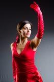 Танцы женщины танцуют в красном платье Стоковые Изображения