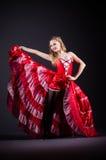 Танцы молодой женщины в красном платье Стоковые Изображения RF