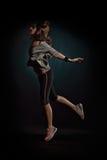 Танцы молодой женщины в студии Стоковое Изображение RF