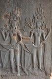 Танцы Apsaras на стене в виске Angkor Wat Стоковое Фото
