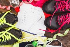 Тапки, одежда, план диеты и измерять ленты Стоковые Изображения RF