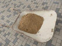 Тачка с песком Стоковое фото RF