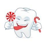 Талисман шаржа зуба ест конфету Стоковое фото RF