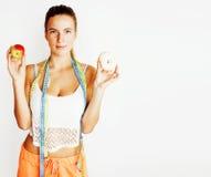 Талия женщины измеряя с лентой на узле любит подарок, tan изолированный конец вверх по белой предпосылке, концепции людей диеты стоковая фотография rf