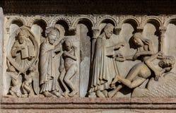 Творение и падение на фасад собора Моденаа Стоковое Фото