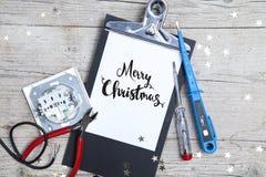 Творческая рождественская открытка для electrican дела Стоковое Фото