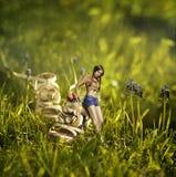 Творческий коллаж изображения с девушкой около ботинка Стоковое Фото