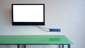 ТВ на изоляте стены на экране Стоковое фото RF