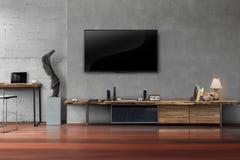 ТВ приведенное на бетонной стене с деревянным столом в живущей комнате Стоковые Фото