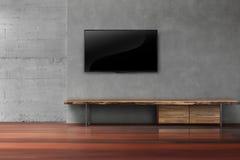 ТВ приведенные на бетонной стене с деревянной мебелью в пустом прожитии r Стоковая Фотография