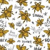 Текстильные ткани картины золотой вышивки пчелы Hohey безшовные оранжевые Стоковое Изображение RF