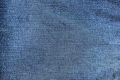 текстура абстрактных голубых джинсыов джинсовой ткани новая Стоковая Фотография