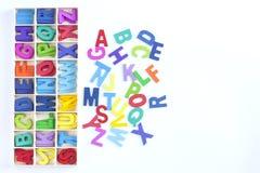 Текстура английского алфавита деревянная красочная дальше над белым backgroun Стоковая Фотография RF