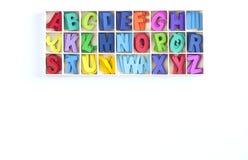 Текстура английского алфавита деревянная красочная дальше над белым backgroun Стоковое фото RF