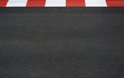 Текстура асфальта гонки мотора и обочина Grand Prix обходят вокруг стоковые фотографии rf