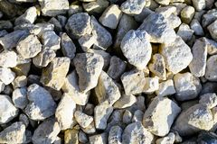 Текстура белых камешков известняка Утесистая предпосылка Стоковые Изображения RF