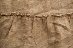 Текстура белья естественной ткани, бежевый цвет, unbleached материал для дизайна стоковые изображения