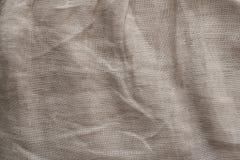 Текстура белья естественной ткани, бежевый цвет, unbleached материал для дизайна стоковое фото rf