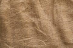 Текстура белья естественной ткани, бежевый цвет, unbleached материал для дизайна стоковое изображение