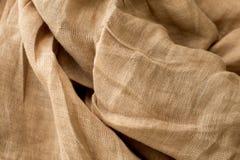 Текстура белья естественной ткани, бежевый цвет, unbleached материал для дизайна стоковая фотография