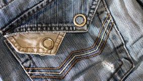 Текстура винтажной предпосылки голубых джинсов, сорванных джинсов Стоковое фото RF