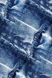 Текстура голубых джинсов - безшовная предпосылка grunge Стоковое Фото