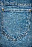 текстура голубых джинсыов ткани карманная Стоковые Фотографии RF