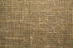 Текстура грубой ткани от цвета рогожки русого стоковая фотография