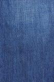 текстура джинсовой ткани предпосылки Стоковая Фотография