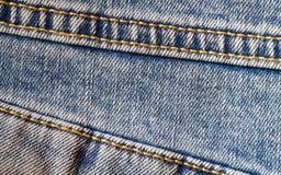 Текстура джинсовой ткани с швом Стоковое Изображение RF