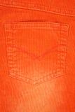 текстура джинсыов померанцовая карманная Стоковое Фото