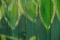 Текстура дерева от загородки и покрашенных листьев Стоковое фото RF