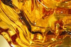 Текстура жидкости золота стоковые фото