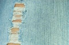 Текстура джинсов джинсовой ткани, старая сорванная дизайна моды джинсов Стоковые Изображения RF