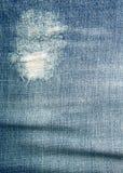 текстура джинсыов джинсовых тканей одежды предпосылки голубая Стоковая Фотография RF