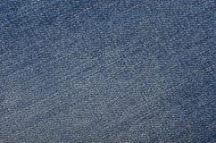 текстура джинсыов джинсовых тканей одежды предпосылки голубая Стоковая Фотография