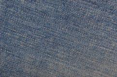 текстура джинсыов джинсовых тканей одежды предпосылки голубая Стоковые Фото
