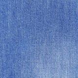 текстура джинсыов ткани детали джинсовой ткани хлопка джинсыы clouse предпосылки голубые освещают вверх Стоковые Изображения