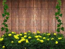 Текстура загородки доск с желтыми цветками Стоковые Изображения RF