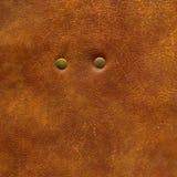 текстура заклепки предпосылки коричневая кожаная к Стоковые Фотографии RF