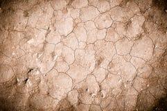 текстура земли треснула на поверхности должной к недостатку воды Стоковые Фотографии RF