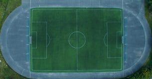 текстура зеленого цвета травы футбола поля предпосылки Стоковое Фото