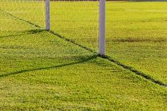 текстура зеленого цвета травы футбола поля предпосылки Стоковое фото RF