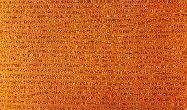 Текстура золота картины ткани на стене стекел Стоковые Фотографии RF