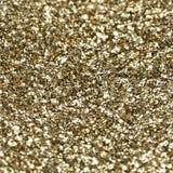 Текстура золота сияющая, желтые sequins с предпосылкой нерезкости Стоковая Фотография